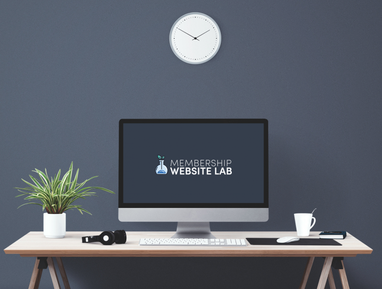 Computer screen with memberlab logo, clock above